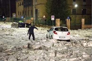 Cars blocked after massive chunks of hail and torrential rain hit Rome, Italy